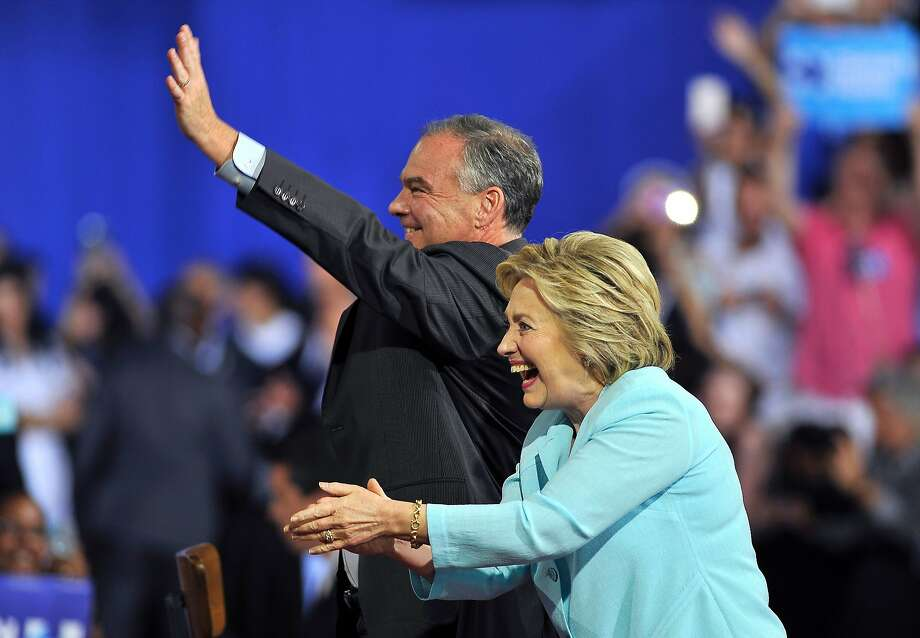 Democratic presidential candidate Hillary Clinton and her running mate Sen. Tim Kaine, D-Va., greet supporters at a campaign rally in Miami. Photo: GASTON DE CARDENAS, AFP/Getty Images
