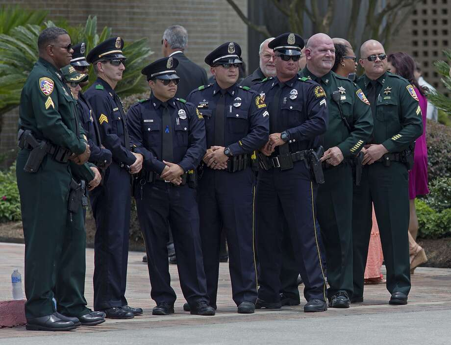 Members of the Dallas Police Department and the East Baton Rouge Sheriff's Office pose for a photo before the funeral services for East Baton Rouge Sheriff deputy Brad Garafola at the Istrouma Baptist Church in Baton Rouge, La., Saturday, July 23, 2016. Multiple police officers were killed and wounded Sunday morning in a shooting near a gas station in Baton Rouge, less than two weeks after a black man was shot and killed by police here, sparking nightly protests across the city. (AP Photo/Max Becherer) Photo: Max Becherer, Associated Press