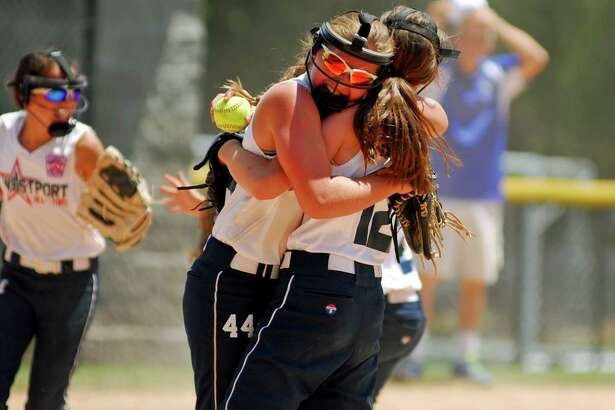 Westport's Morgan Carnahan celebrates with a teammate after winning the U10 Section 1 softball title.