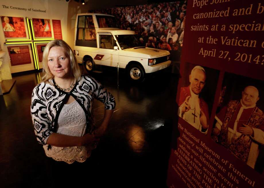 Genevieve Keeney, president and COO of the National Museum of Funeral History, hopes the exhibit will give visitors a glimpse of the Vatican and its colorful history and traditions. Photo: Melissa Phillip, Staff / © 2016 Houston Chronicle