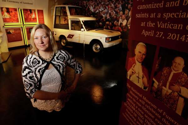 Genevieve Keeney, president and COO of the National Museum of Funeral History, hopes the exhibit will give visitors a glimpse of the Vatican and its colorful history and traditions.