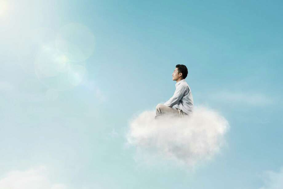 The man is floating in the sky ride above the clouds Photo: Yagi Studio, Contributor / Yagi Studio