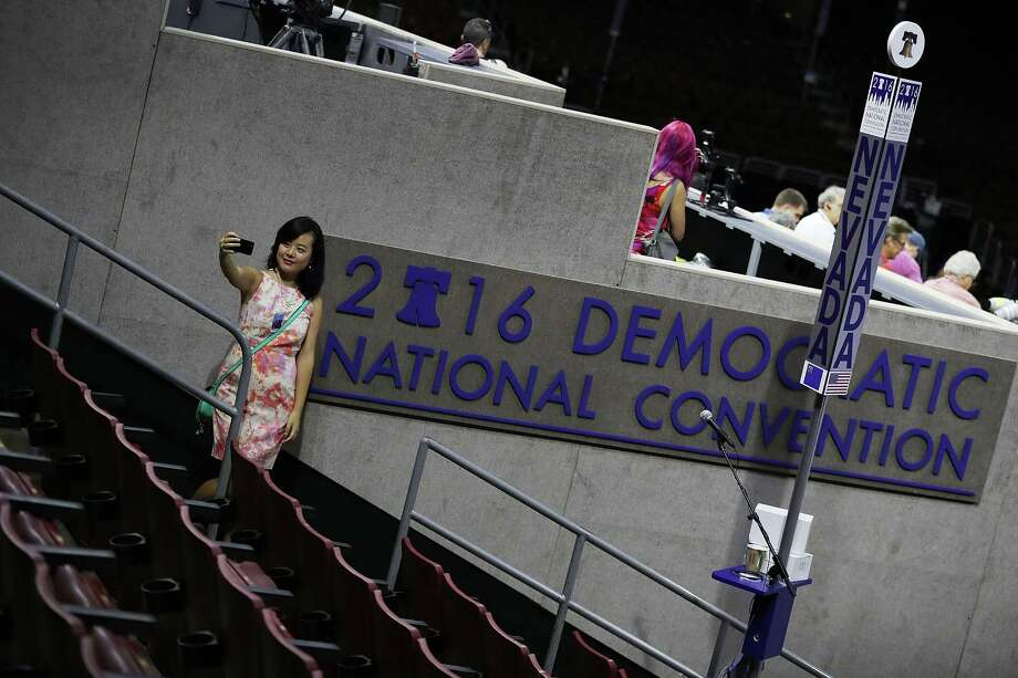 Winnie Wang takes a selfie at the Wells Fargo Center before the start of the Democratic National Convention, which runs Monday through Thursday. Photo: Joe Raedle / Getty Images / 2016 Getty Images