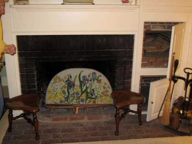 Elizabeth Lane's home still features the Dutch ovens surrounding the main fireplace. They were once a favorite hiding spot for her eight children, she said. Photo: Maggie Gordon / Darien News