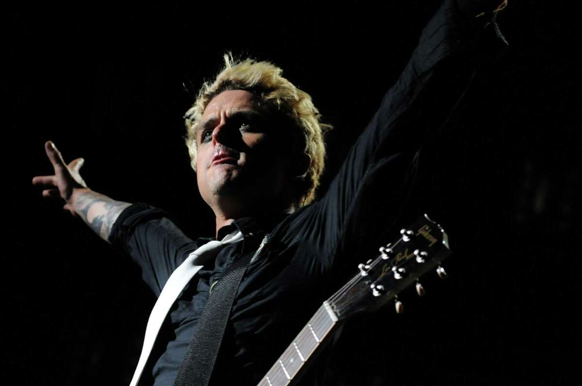 Green Day's lead singer and guitarist, Billie Joe Armstrong, performs live with the band at The Comcast Theatre in Hartford on Thursday evening Aug. 12, 2010.