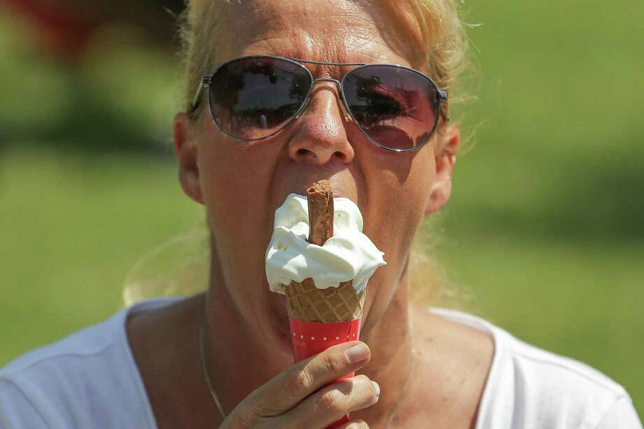 Eating ice cream has helped some people ease migraine headaches. Photo: DANIEL LEAL-OLIVAS, Stringer / AFP or licensors