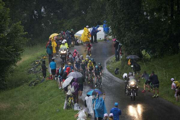 Sky teammates set the pace for Britain's Chris Froome, wearing the overall leader's yellow jersey, to prevent his main rivals from breaking away during the twentieth stage of the Tour de France cycling race over 146.5 kilometers (90.7 miles) with start in Megeve and finish in Morzine-Avoriaz, France, Saturday, July 23, 2016. (AP Photo/Peter Dejong)