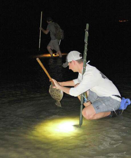An evening spent gigging flounder in the shallows of a Texas bay is a traditional, and often very productive, way anglers avoid the miserable heat and blazing sunlight of summer days. Photo: Shannon Tompkins / Houston Chronicle