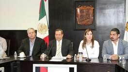Coahuila attorney general Homero Ramos Gloria (middle, black suit) speaks to state legislators about the states' investigation into killings by the Zetas drug cartel in the Piedras Negras, Mexico, region on July 20, 2016.
