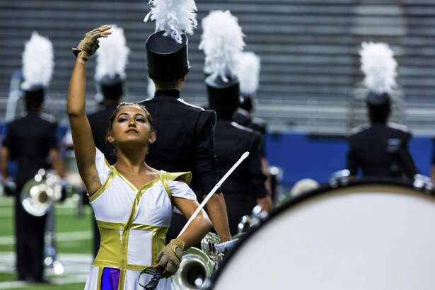 A member of the Genesis color guard, of Austin, Texas, holds her pose during a performance for the Drum Corps International Championship at the Alamodome in San Antonio on Saturday, July 23, 2016. From states all across the nation, the twenty-four groups competed for a position at the World Championships in August. Groups are representative of the cities they live in with ages ranging from 14 to 20 years old.