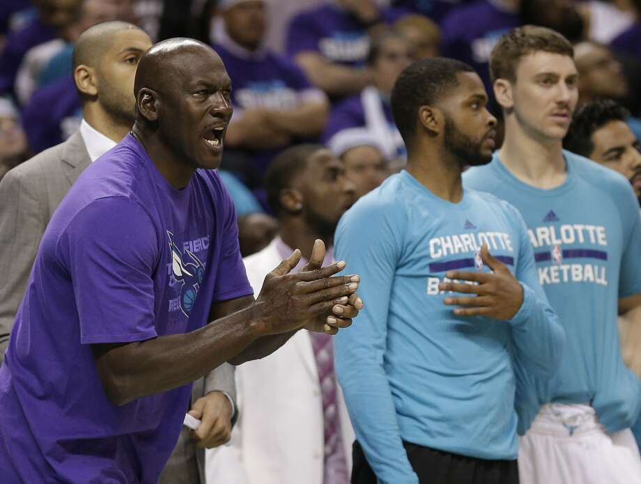 Charlotte Hornets owner Michael Jordan (left) has an opportunity to help bring North Carolina's diverse political factions together. Photo: Chuck Burton, Associated Press
