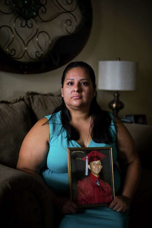 Debra De La Garza holds her son's graduation image at her home in San Antonio, on Tuesday, July 19, 2016. Garza lost her 19-year-old son, Manuel Carvajal, to a drug overdose last year and is now planning a memorial service, set for late August, in addition to being active in overdose recognition in San Antonio. Photo: BRITTANY GREESON, Staff / San Antonio Express-News / © 2016 San Antonio Express-News