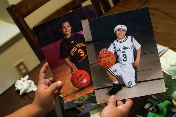 Debra De La Garza holds portraits of her son from his time as a youth athlete at her home in San Antonio, on Tuesday, July 19, 2016. Garza lost her 19-year-old son, Manuel Carvajal, to a drug overdose last year and is now planning a memorial service, set for late August, in addition to being active in overdose recognition in San Antonio.