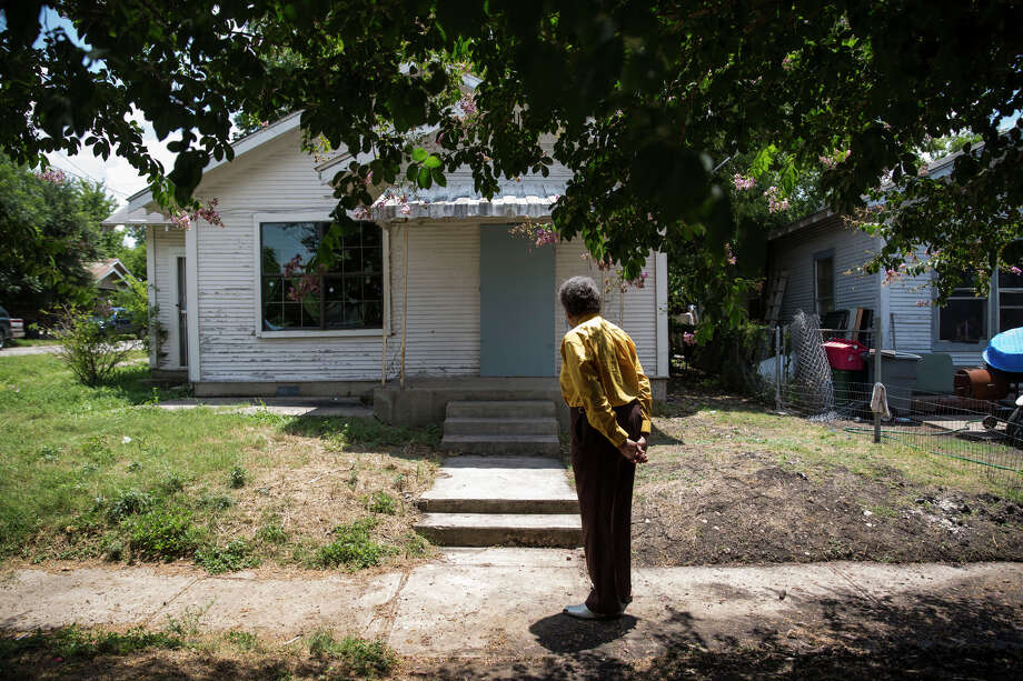 Nathaniel Word stands outside of his childhood home in San Antonio, Texas on July 1, 2016.  He was acquitted in the murder of Anthony Coronado, an event which occurred in the front yard of Word's home.  Word no longer considers it a safe place to live. Photo: Carolyn Van Houten / Carolyn Van Houten / 2016 San Antonio Express-News