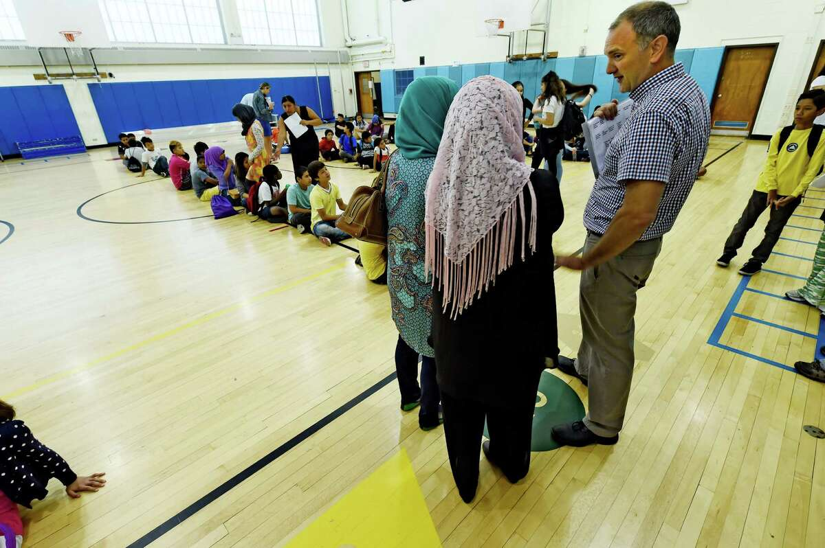 Students and faculty prepare for the day of classes in the Newcomer Academy held at the Thomas O'Brien School Tuesday July 12, 2016 in Albany, N.Y. (Skip Dickstein/Times Union)