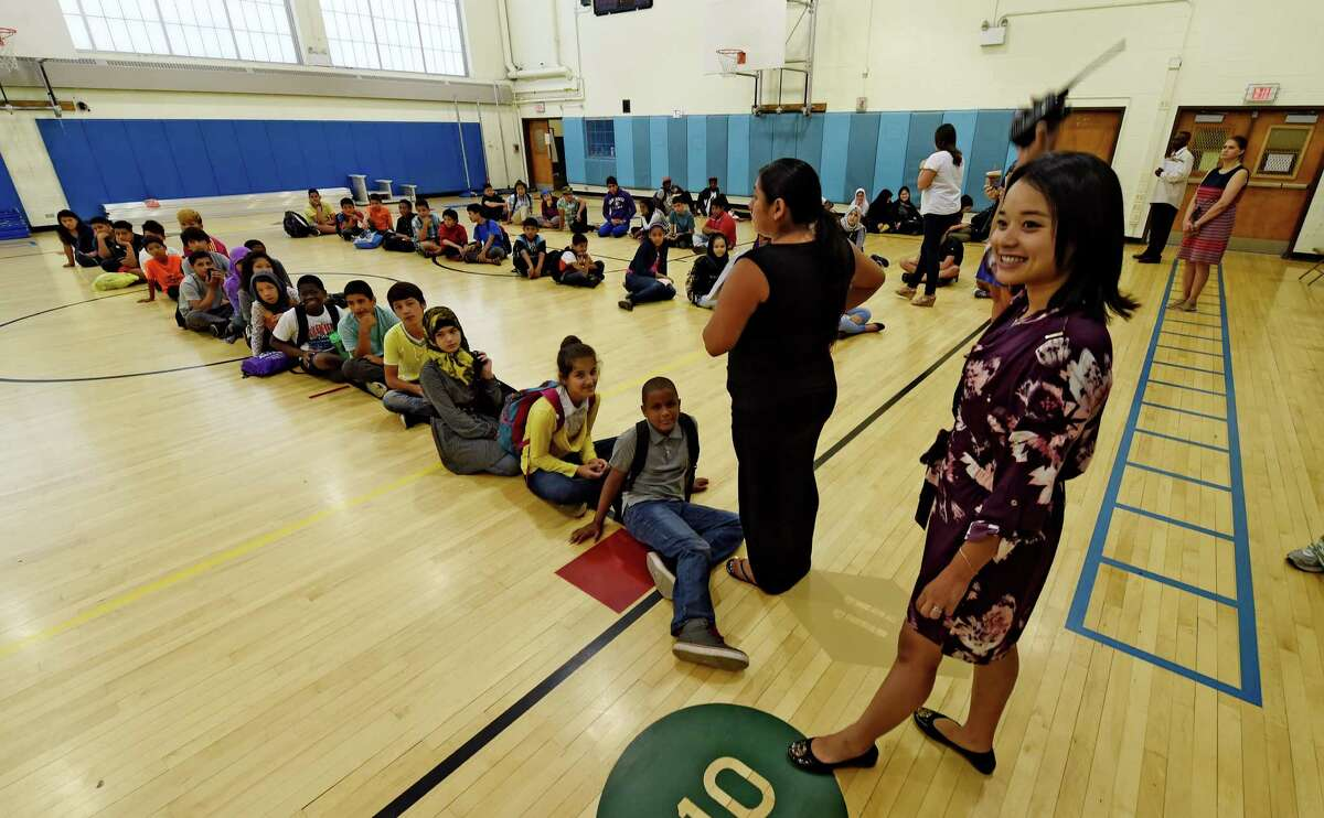 Lily Htoo gets Students and faculty organized for a day of classes in the Newcomer Academy held at the Thomas O'Brien School Tuesday July 12, 2016 in Albany, N.Y. (Skip Dickstein/Times Union)