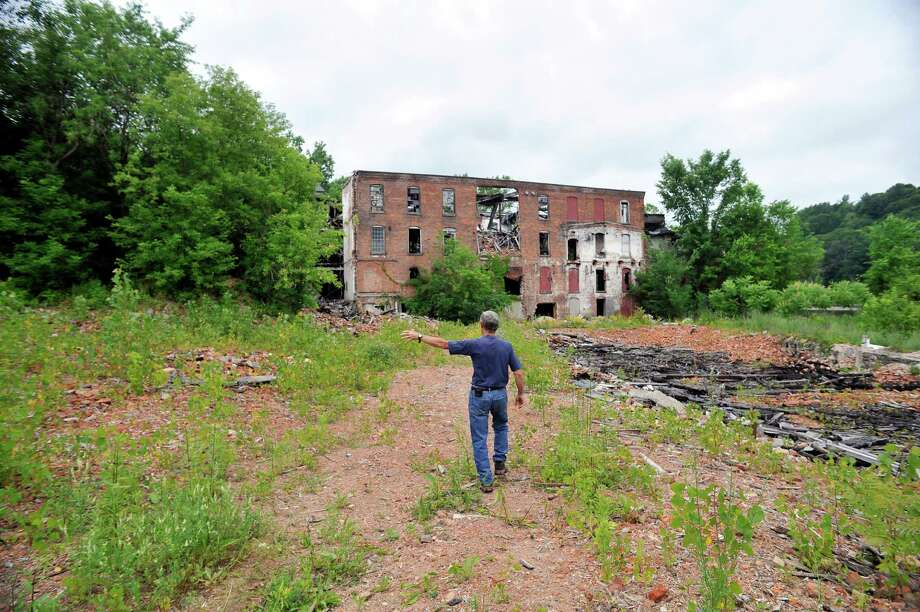 Richard Andrew, mayor of Valley Falls, talks about the former Thompson textile mill site on Tuesday, June 28, 2016, in Valley Falls, N.Y.    (Paul Buckowski / Times Union) Photo: PAUL BUCKOWSKI / 40037093A
