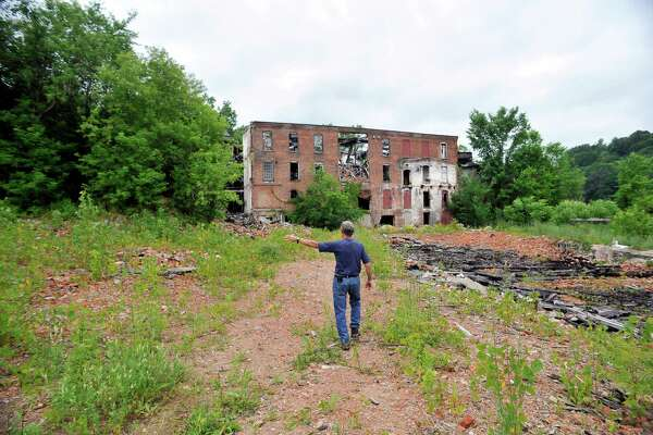 Richard Andrew, mayor of Valley Falls, talks about the former Thompson textile mill site on Tuesday, June 28, 2016, in Valley Falls, N.Y.    (Paul Buckowski / Times Union)