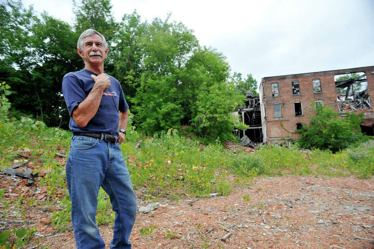 Richard Andrew, mayor of Valley Falls, talks about the former Thompson textile mill site on Tuesday, June 28, 2016, in Valley Falls, N.Y. The village applied for an EPA grant to test the property for contamination but was rejected. (Paul Buckowski / Times Union)