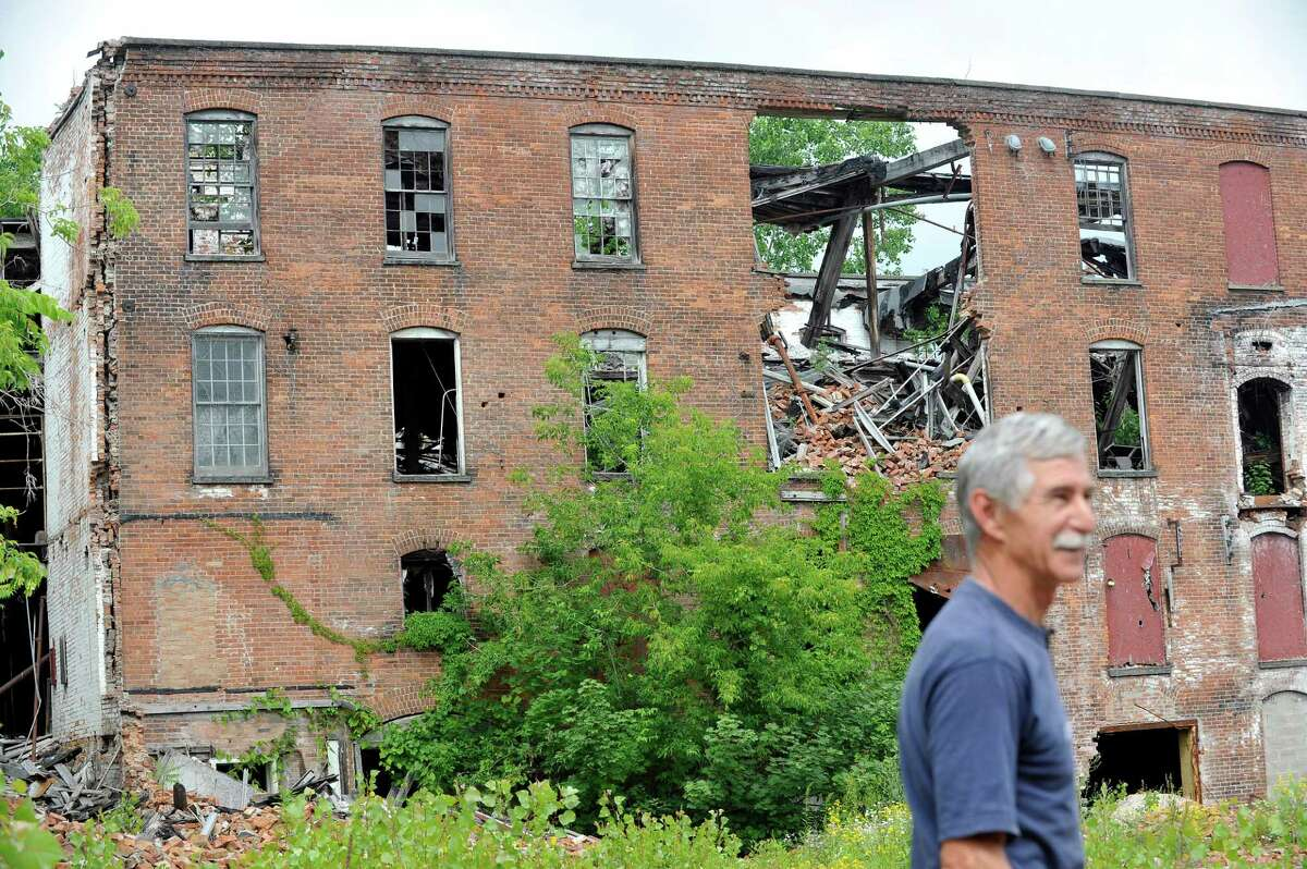 Richard Andrew, mayor of Valley Falls, at the former Thompson textile mill site on Tuesday, June 28, 2016, in Valley Falls, N.Y. The sat has been left half demolished since a 2009 fire. (Paul Buckowski / Times Union)