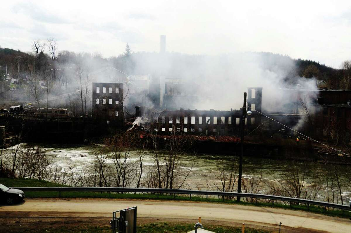 Smoke pours from the James Thompson Mill, on Rt. 67 in the town of Valley Falls N.Y. The scene of a early morning fire that destroyed the old mill on Wednesday, April 22, 2009. (James Goolsby /Times Union archive)