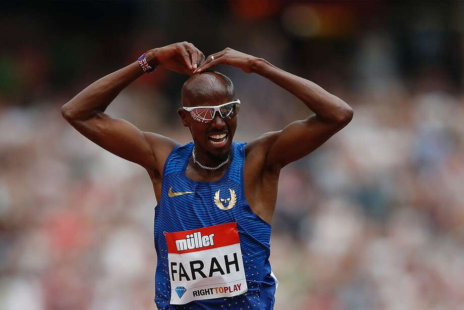 "Britain's Mo Farah does his trademark ""mobot"" gesture after winning the men's 5,000 meters Saturday in London. Photo: ADRIAN DENNIS, AFP/Getty Images"