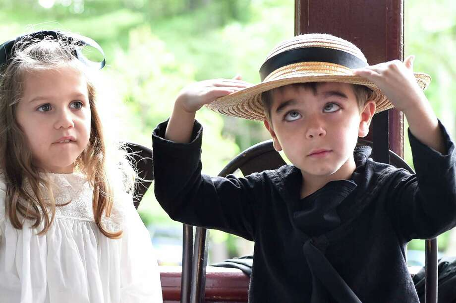 Joseph Greene, 4, of Schuylerville, right, keeps himself entertained during a re-enactment of Ulysses S. Grant's funeral for Grant Remembrance Day on Saturday, July 23, 2016, at Grant Cottage in Wilton, N.Y. Joseph and his twin sister, Savannah Greene, left, wore period clothes and portrayed Grant's family members. (Cindy Schultz / Times Union) Photo: Cindy Schultz / Albany Times Union