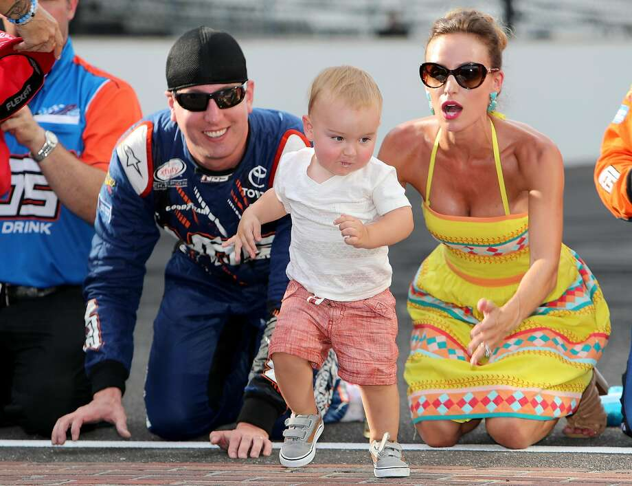 Kyle Busch (left) kisses the bricks at the Indianapolis Motor Speedway with wife Samantha and son Brexton. Photo: Rey Del Rio, Getty Images