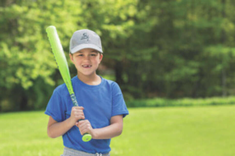 Photo provided With the help of infusion treatments from MidMichigan Home Care, 8-year-old Luke Barriger is able to keep playing baseball.