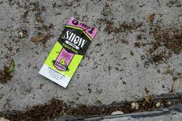 An empty package of cigarillos is shown among scattered tobacco in a known drug area along Fannin and Wheeler near Peggy Park Wednesday, June 29, 2016, in Houston. Drug users often empty the tobacco from the cigarillos and fill the shell with Kush.  ( Melissa Phillip / Houston Chronicle )