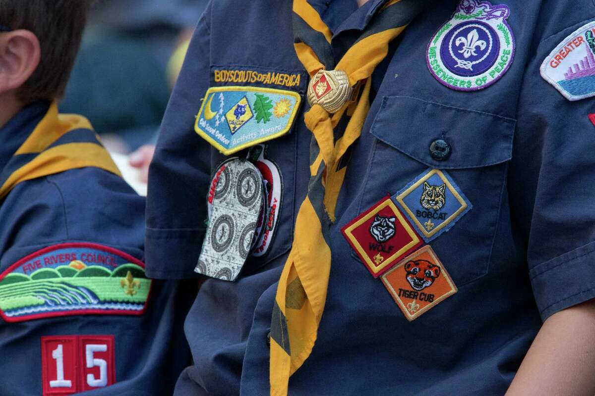 FILE - In this Saturday, June 25, 2016 photo, Cub Scouts watch a race during the Second Annual World Championship Pinewood Derby in New York's Times Square. (AP Photo/Mary Altaffer)