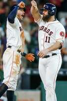 Houston Astros catcher Evan Gattis (11) celebrates his home run with shortstop Carlos Correa (1) as the Houston Astros take on the Los Angeles Angels at Minute Maid Park Saturday, July 23, 2016 in Houston.