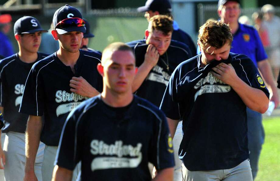 Stratford team members walk back to the dugout after being defeated by Waterbury after 10 innings of American Legion Super Regional baseball playoff action in Middletown, Conn. on Saturday July 23, 2016. Photo: Christian Abraham / Hearst Connecticut Media / Connecticut Post