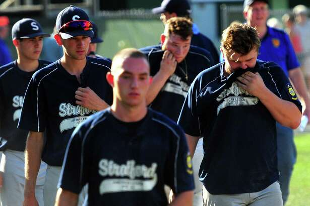 Stratford team members walk back to the dugout after being defeated by Waterbury after 10 innings of American Legion Super Regional baseball playoff action in Middletown, Conn. on Saturday July 23, 2016.