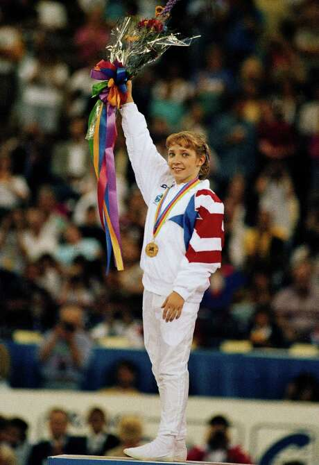 Houston's Kim Zmeskal won the gold medal in the women's all-around at the 1991 World Gymnastics competition. She added a bronze medal in the 1992 Games. Photo: Mike Conroy, STF / 1991 AP