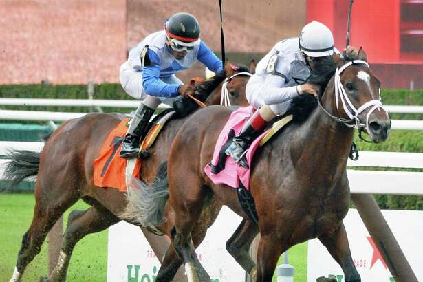 Royal Copy, left, with Ricardo Santana, Jr. up fails to catch One Liner risen by John Velazquez in the 6th race on the season's first Saturday at the track July 23, 2016 in Saratoga Springs, NY.  (John Carl D'Annibale / Times Union)