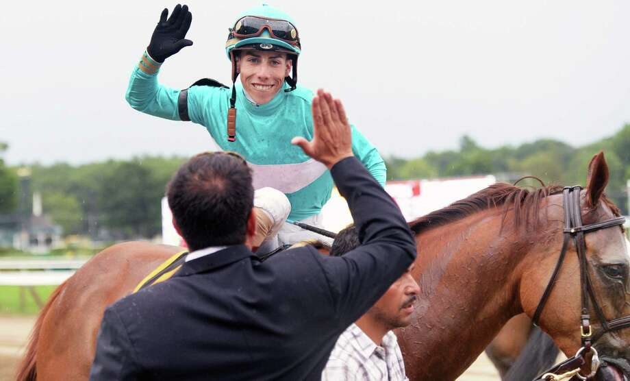 Jockey Irad Ortiz Jr. #6, high fives an owner after winning the 79th Running of the Diana aboard Dacita at Saratoga Race Course Saturday July 23, 2016 in Saratoga Springs, NY.  (John Carl D'Annibale / Times Union) Photo: John Carl D'Annibale / 20037384A