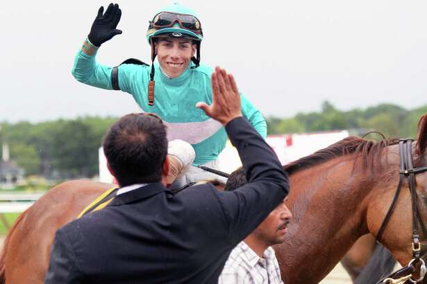 Jockey Irad Ortiz Jr. #6, high fives an owner after winning the 79th Running of the Diana aboard Dacita at Saratoga Race Course Saturday July 23, 2016 in Saratoga Springs, NY.  (John Carl D'Annibale / Times Union)