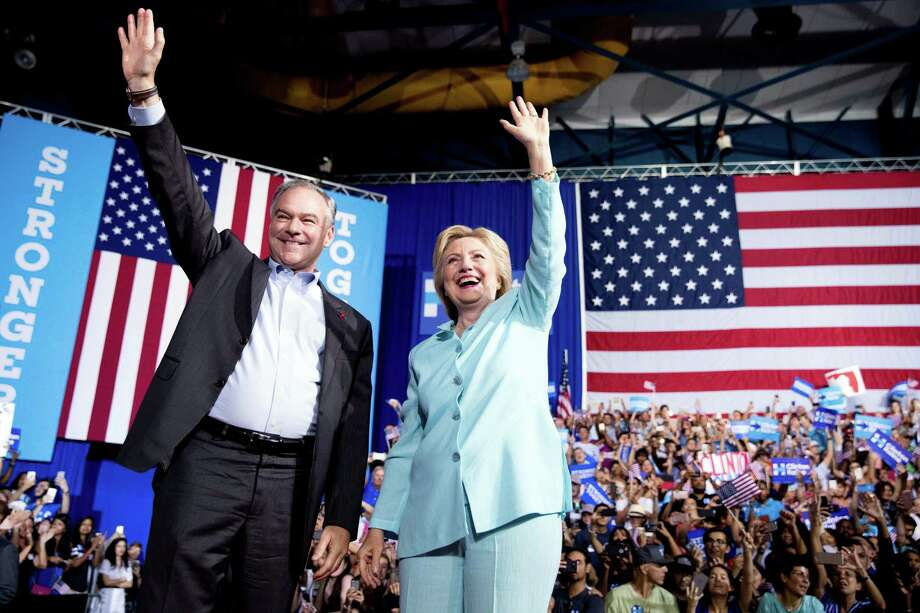Democratic presidential candidate Hillary Clinton and Sen. Tim Kaine, D-Va., arrive at a rally at Florida International University Panther Arena in Miami, Saturday, July 23, 2016. Clinton has chosen Kaine to be her running mate. (AP Photo/Andrew Harnik) Photo: Andrew Harnik, STF / Copyright 2016 The Associated Press. All rights reserved. This material may not be published, broadcast, rewritten or redistribu