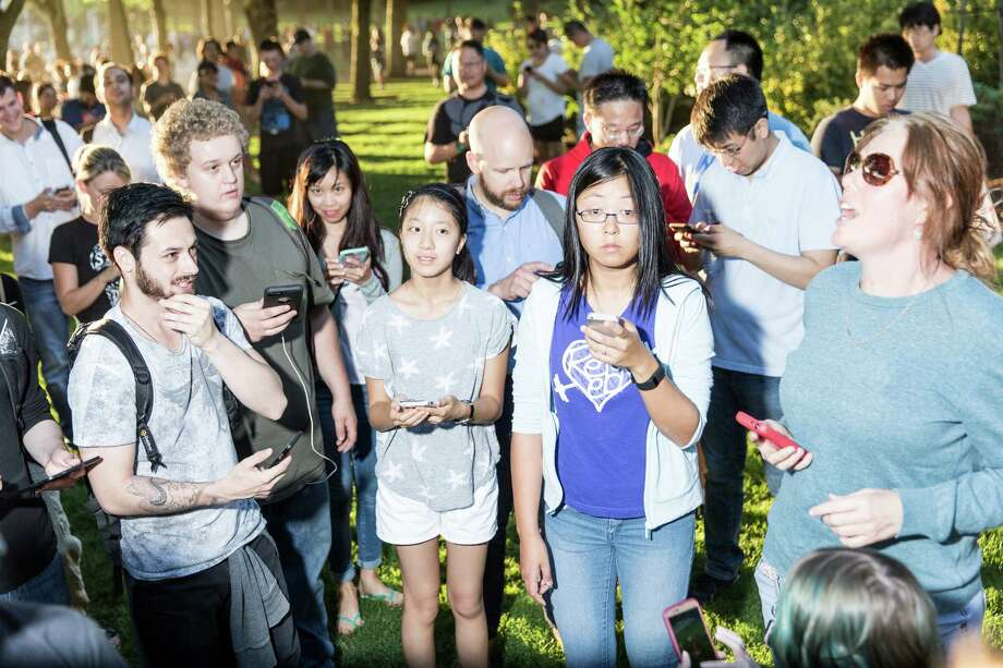 Hundreds of Pokemon Go players gather at Bellevue Downtown Park, Wednesday, July 20, 2016. Photo: GRANT HINDSLEY, SEATTLEPI.COM / SEATTLEPI.COM