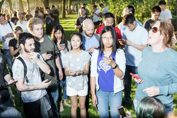 Hundreds of Pokemon Go players gather at Bellevue Downtown Park, Wednesday, July 20, 2016.