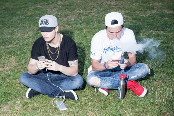 Pokemon Go players play at Bellevue Downtown Park, Wednesday, July 20, 2016.