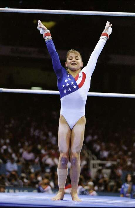 Dominique Moceanu learned about the ups and downs of life during her successful gymnastics career.  Photo: Doug Pensinger, Staff / This content is subject to copyright.