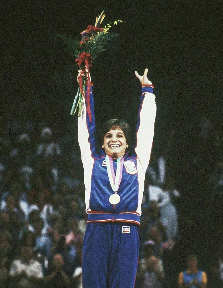 Mary Lou Retton celebrates her gold in the all-around at the 1984 Los Angeles Games. Photo: Maze, POOL / AP1984