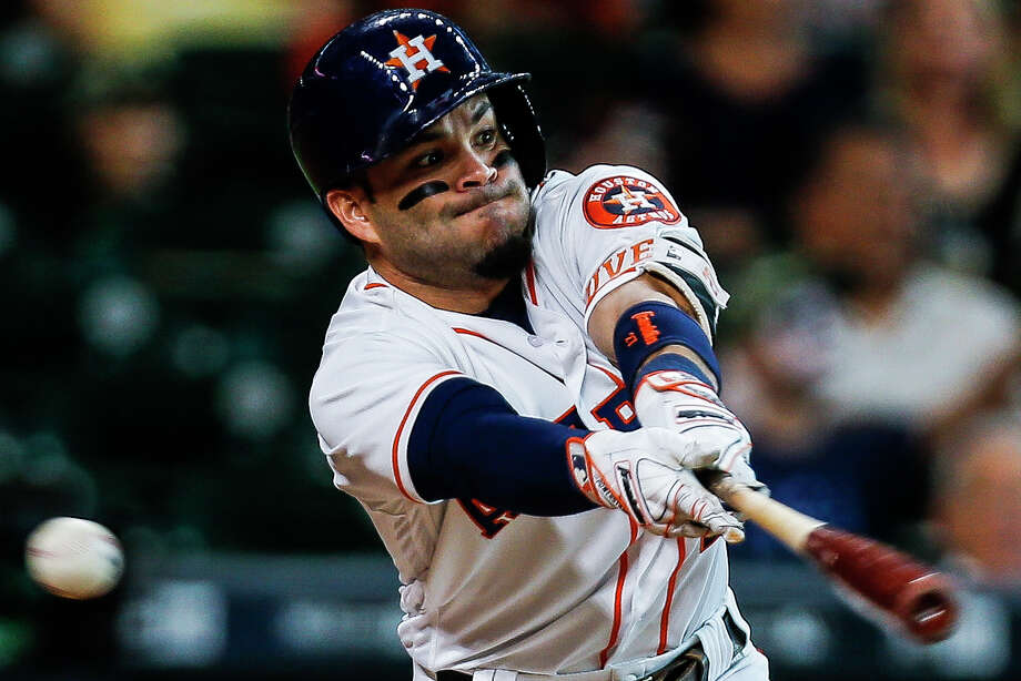 Though Astros second baseman Jose Altuve couldn't quite catch up to this pitch while finishing 1-for-4 in Saturday night's 7-2 win over the Angels, he remains the AL's leading batter with a .357 average. Photo: Michael Ciaglo, Staff / © 2016  Houston Chronicle