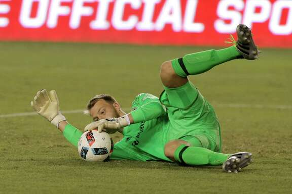 Houston Dynamo goalkeeper Joe Willis makes a save against the Vancouver Whitecaps during the first half during an MLS soccer match Saturday, July 23, 2016, in Houston. (AP Photo/Bob Levey)