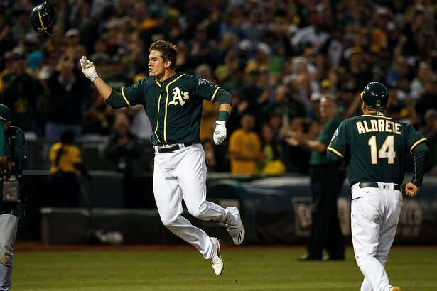 OAKLAND, CA - JULY 23:  Ryon Healy #48 of the Oakland Athletics celebrates after hitting a walk off home run against the Tampa Bay Rays during the ninth inning at the Oakland Coliseum on July 23, 2016 in Oakland, California. The Oakland Athletics defeated the Tampa Bay Rays 4-3. (Photo by Jason O. Watson/Getty Images)