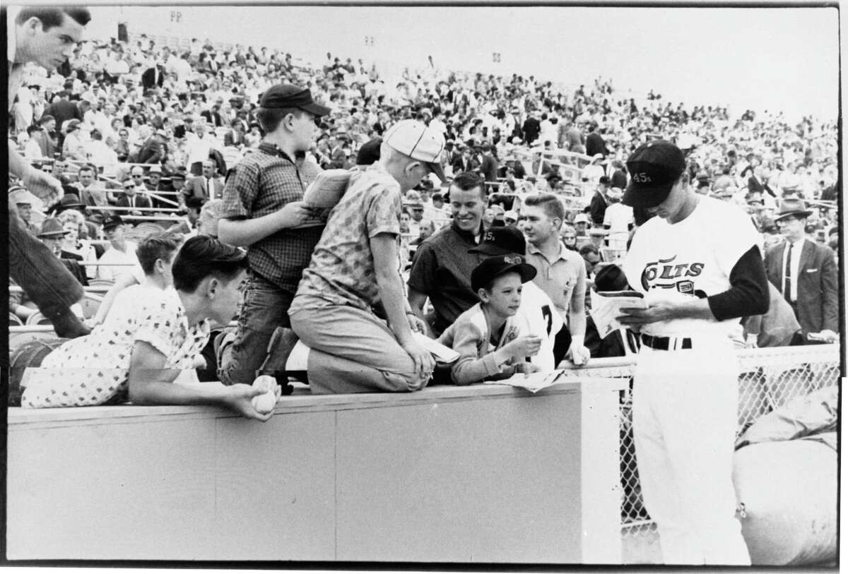 04/10/1962 - Colt 45s second baseman Joe Amalfitano signs autographs. The Houston Colt .45s made their National League franchise debut April 10, 1962 with an 11-2 victory over the Chicago Cubs before 25,271 at Colt Stadium.