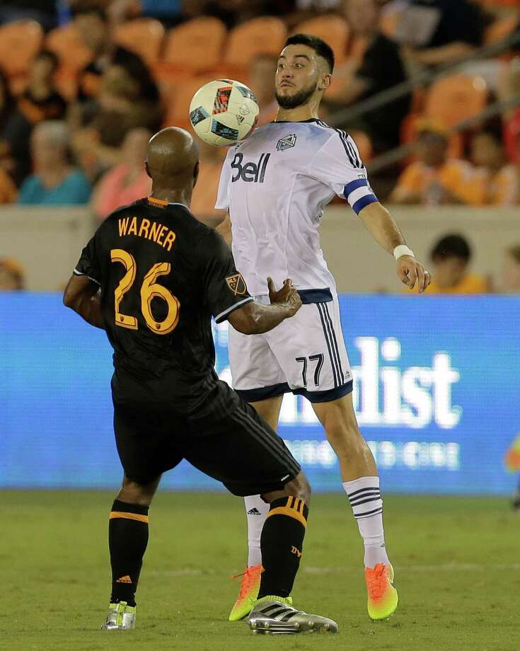Vancouver Whitecaps midfielder Pedro Morales (77) chests the ball in front of Houston Dynamo midfielder Collen Warner (26) during the first half during an MLS soccer match Saturday, July 23, 2016, in Houston. (AP Photo/Bob Levey) Photo: Bob Levey, FRE / AP