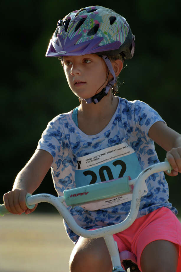 Casey Small, 6, a first grader at Bernshausen Elementary in Tomball, Woodlands, finishes the biking portion of the 2016 The Woodlands Kids Triathlon at The Woodlands Family YMCA at Branch Crossing on Saturday, July 23, 2016.  Photo: Jerry Baker, For The Chronicle / Freelance